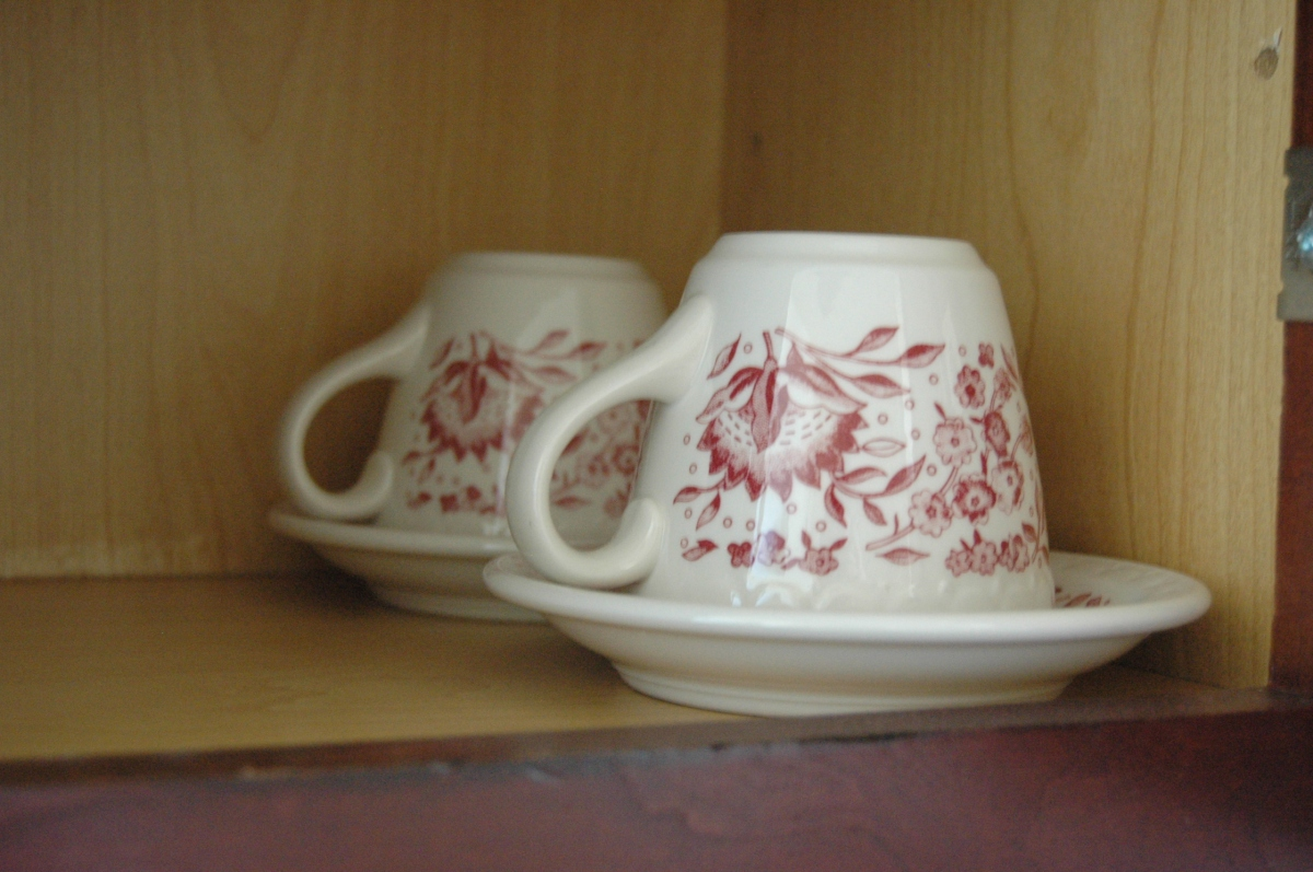 Two tea cups in the hotel cabinet - Old Towne Hotel, Wichita, KS