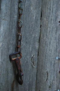 Rusted chain on the schoolhouse door - Safe Haven Farm, Haven, KS