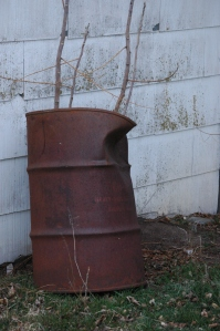 Rusted barrel against the garden shed - Safe Haven Farm, Haven, KS