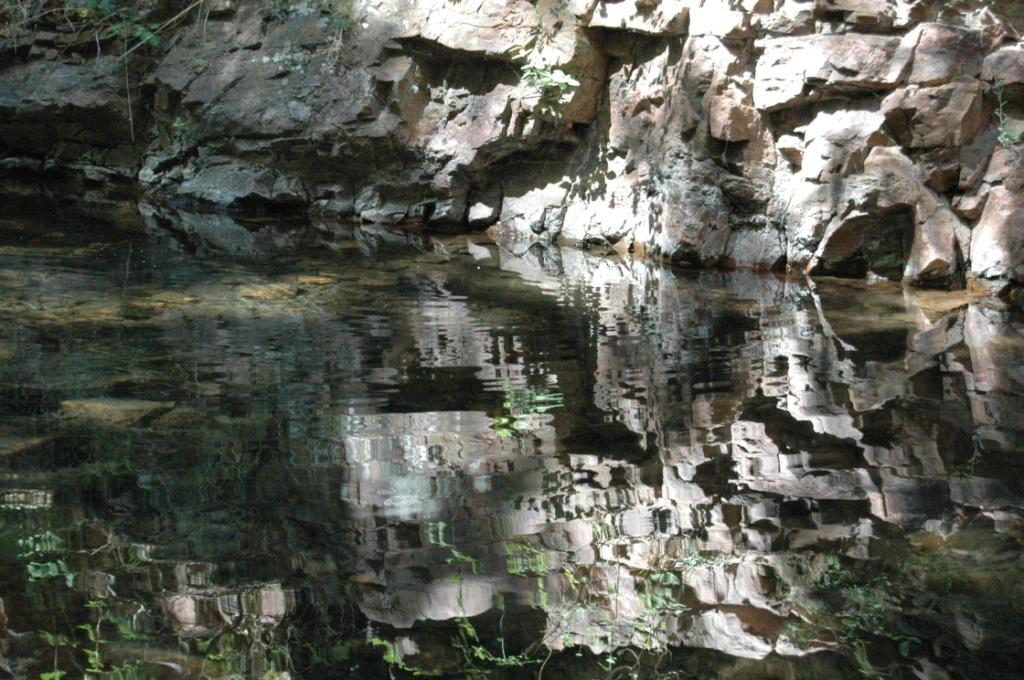 Rocks reflected in rippling waters at Glen Eyrie, Colorado Springs, CO
