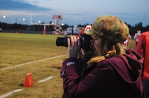 Katie taking football photos in Hutchinson, KS