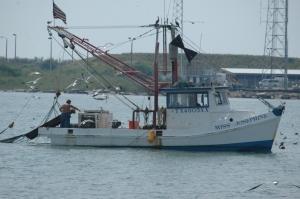 Little shrimp boat shot from the the Galveston Ferry, Galveston, TX