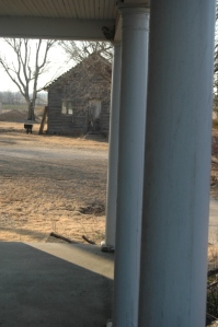 Front porch pillars and the old schoolhouse at Safe Haven Farm, Haven, KS