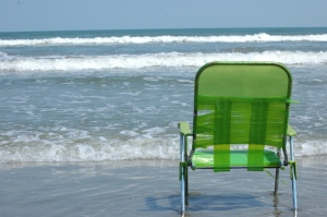Beach chair overlooking the waves on Jamaica Beach, Galveston, TX