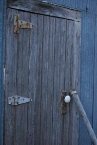 Old broken door to the granary at Safe Haven Farm, Haven, KS