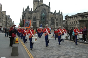 Random marching band coming down the Royal Mile, Edinburgh, Scotland