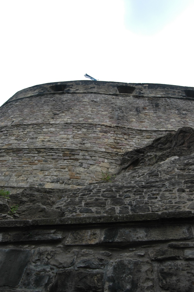 Scottish flag flying at the top of the walls of Edinburgh Castle, Edinburgh, Scotland