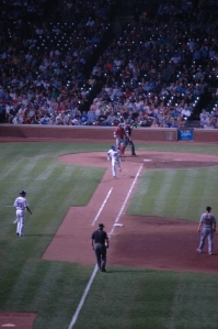 Cubs baseball player running for first base at Wrigley Field, Chicago, IL
