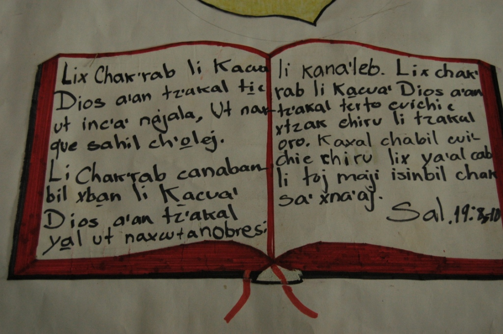 Handwritten poster of Psalm 19:8-10 in Kekchi on the wall of a church in Peten, Guatemala