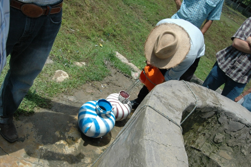 Drawing water from a well in Se'tul, Peten, Gutemala