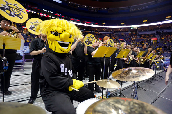 WuShock playing drums with the band