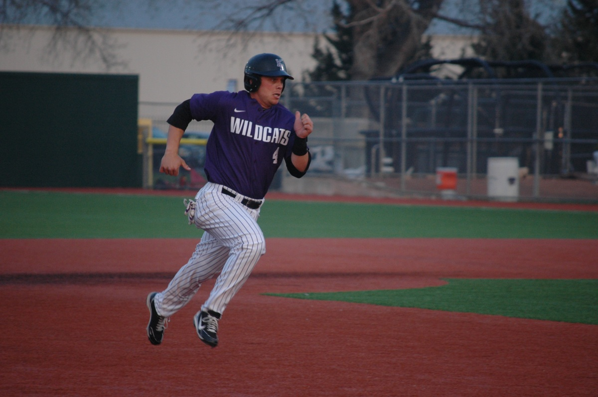 K-State baseball player running for home, Manhattan, KS