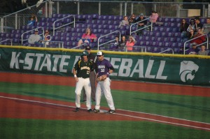 Baseball players from Baylor and K-State standing at first base, Manhattan, KS