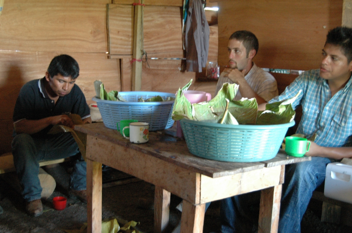 Tubs of homemade pork tamales made by a Kekchi village to feed us, Esfuerzo II, Peten, Guatemala